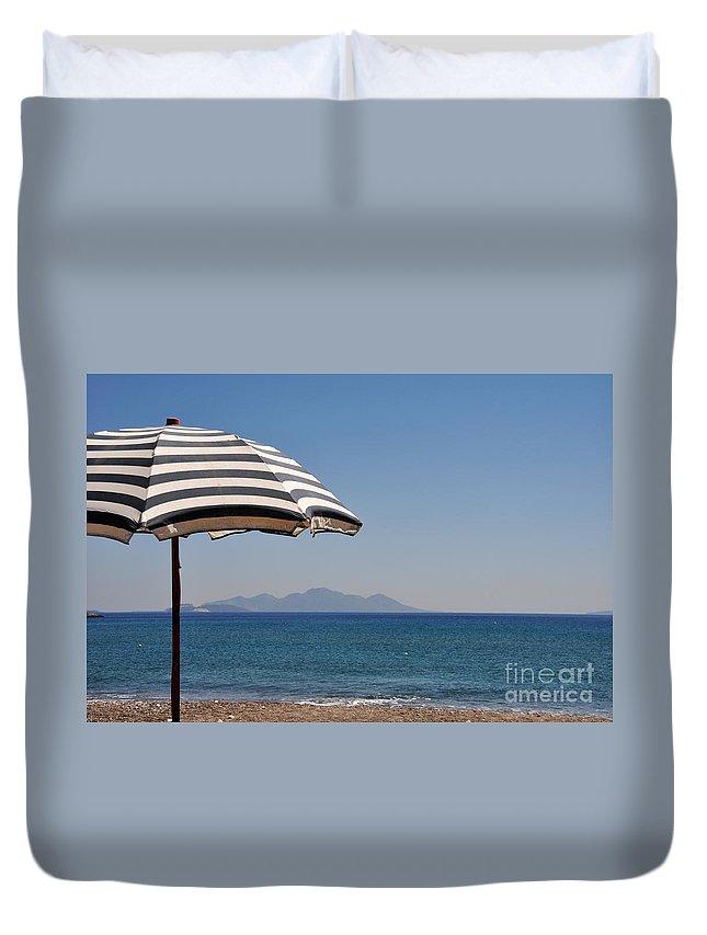 Umbrella Duvet Cover featuring the photograph Beach Umbrella by Luis Alvarenga