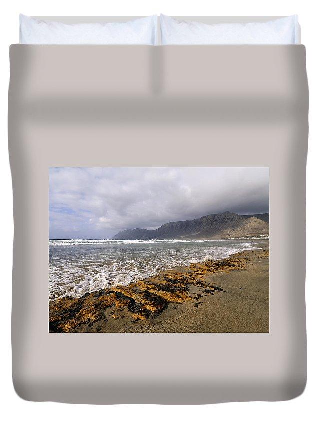 Beach Duvet Cover featuring the photograph Caleta De Famara Beach On Lanzarote by Karol Kozlowski