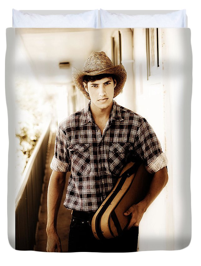Angry Duvet Cover featuring the photograph Cowboy Carrying Guitar by Jorgo Photography - Wall Art Gallery