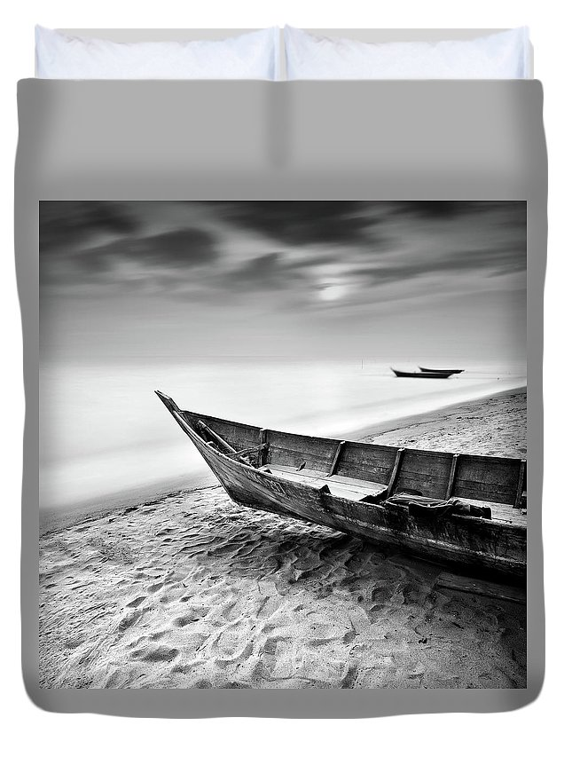 Tranquility Duvet Cover featuring the photograph Fisherman Boat At Beach In Black And by Photography By Azrudin