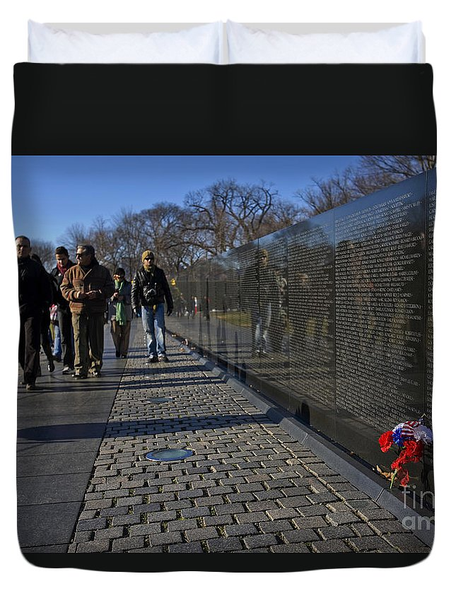 Flowers Duvet Cover featuring the photograph Flowers Left At The Vietnam War Memorial by B Christopher