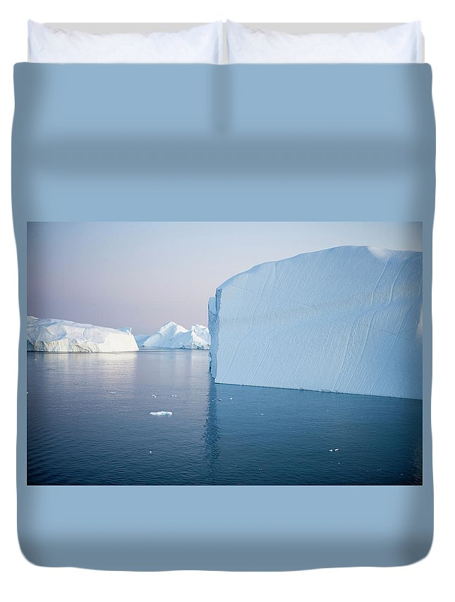 Melting Duvet Cover featuring the photograph Icebergs Of Ilulissat Kangerlua by Holger Leue