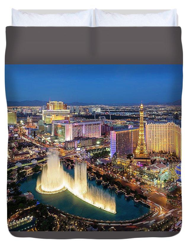 Las Vegas Replica Eiffel Tower Duvet Cover featuring the photograph Las Vegas Skyline At Dusk by Sylvain Sonnet