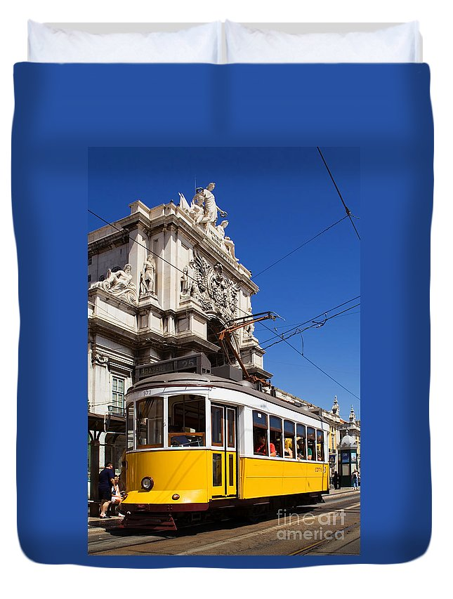 Lisbon Duvet Cover featuring the photograph Lisbon's Typical Yellow Tram In Commerce Square by Jose Elias - Sofia Pereira