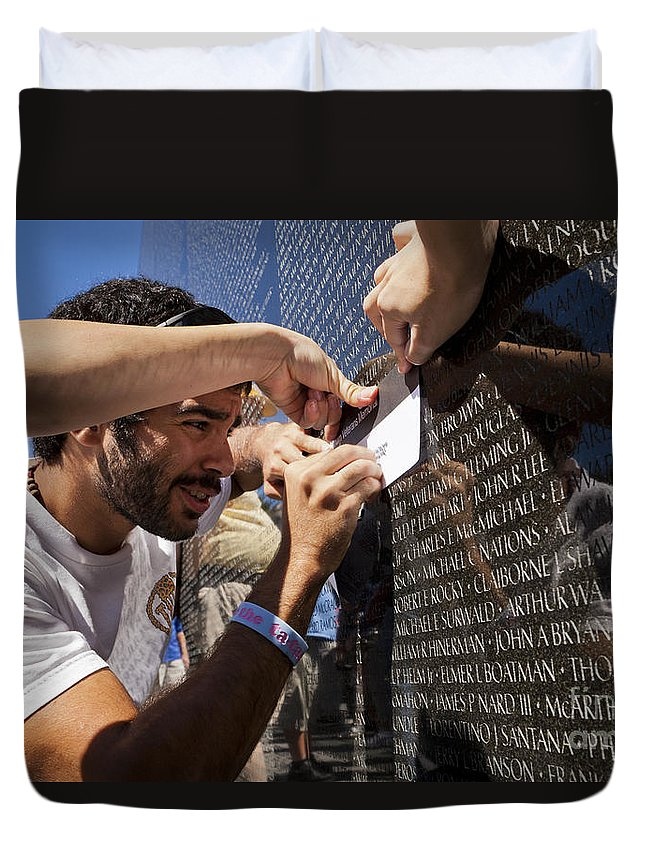 Vietnam Duvet Cover featuring the photograph Man Getting A Rubbing Of Fallen Soldier's Name At The Vietnam War Memorial by B Christopher