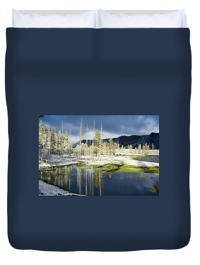 Snow Duvet Cover featuring the photograph Summer Snow In Yellowstone by Karen Lindquist