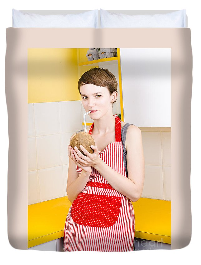 Alternative Duvet Cover featuring the photograph Woman Drinking Coconut Milk In Kitchen by Jorgo Photography - Wall Art Gallery