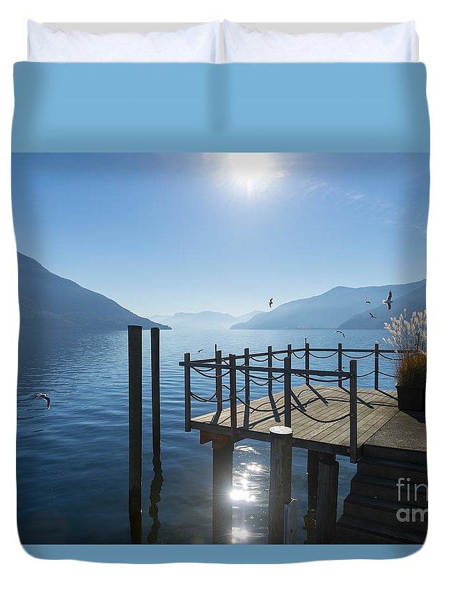 Pier Duvet Cover featuring the photograph Pier by Mats Silvan