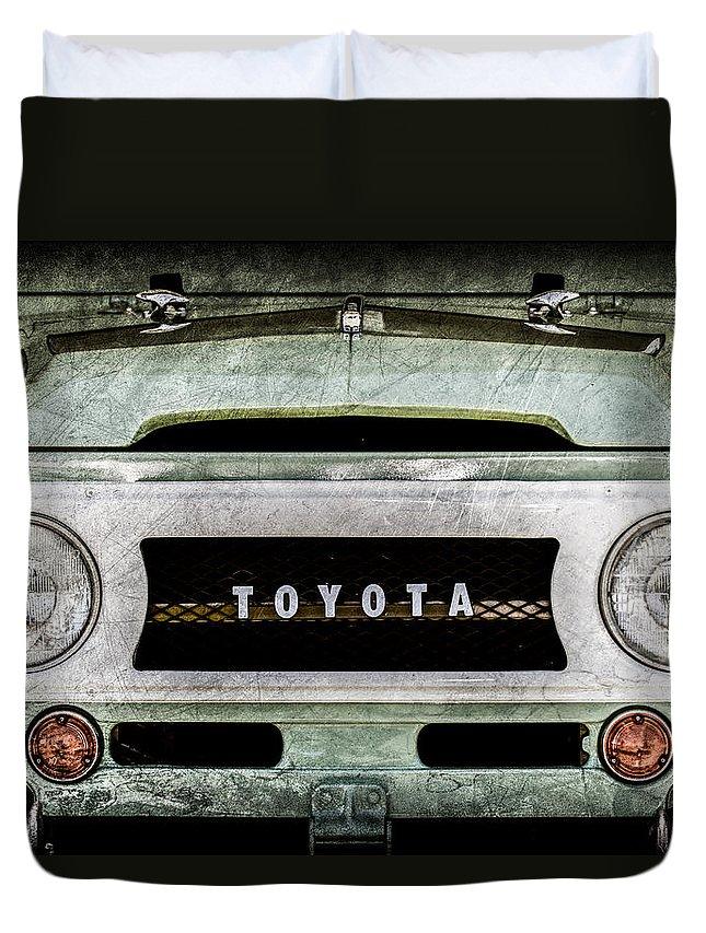 1969 Toyota Fj-40 Land Cruiser Grille Emblem Duvet Cover featuring the photograph 1969 Toyota Fj-40 Land Cruiser Grille Emblem -0444ac by Jill Reger
