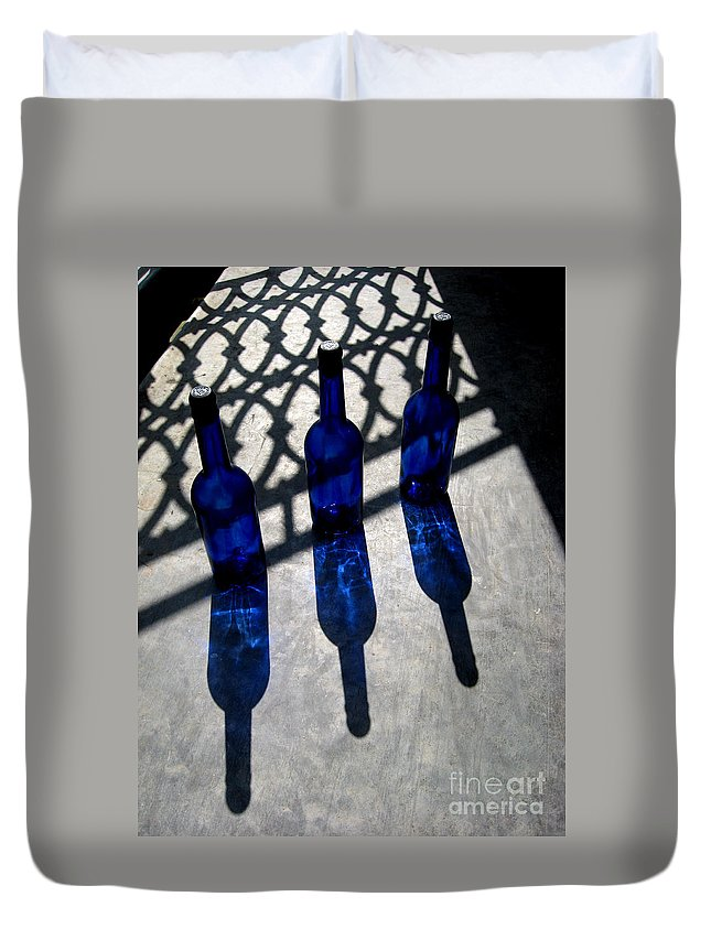 Light Duvet Cover featuring the photograph Bottles Shadows And Sunlight by Caroline Peacock