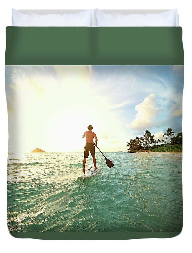 Tranquility Duvet Cover featuring the photograph Caucasian Man On Paddle Board In Ocean by Colin Anderson Productions Pty Ltd