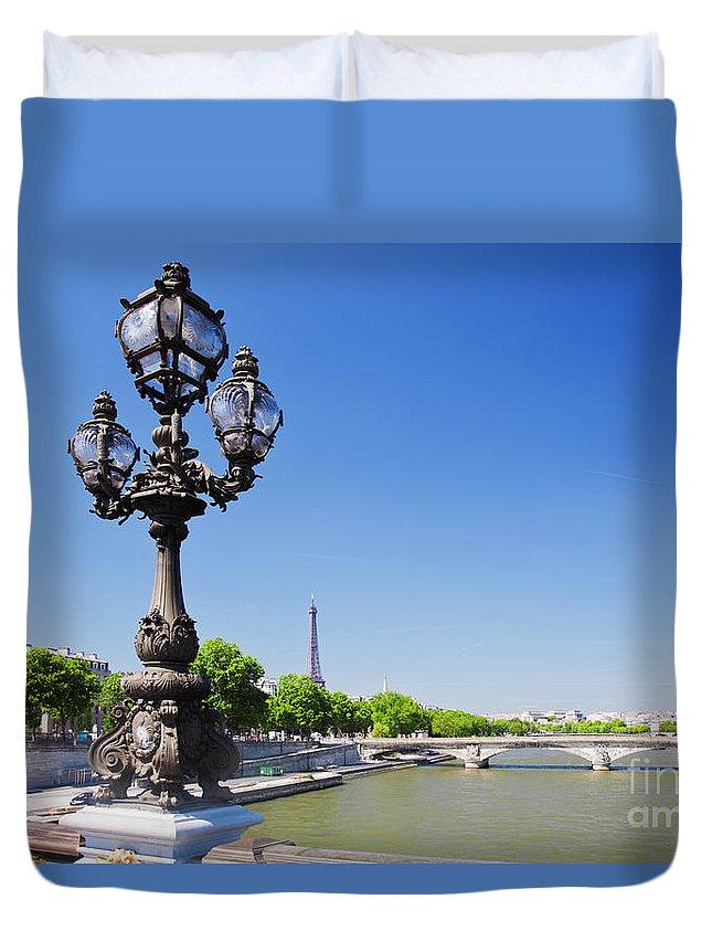 Paris Duvet Cover featuring the photograph Eiffel Tower And Bridge On Seine River In Paris by Michal Bednarek