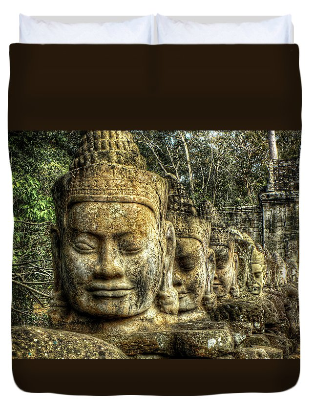 Stone Heads Duvet Cover featuring the photograph Guardians Of Angkor Thom by Douglas J Fisher