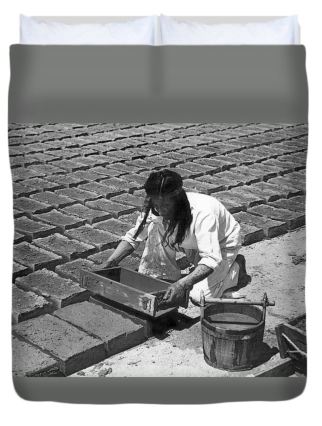 1 Person Duvet Cover featuring the photograph Indians Making Adobe Bricks by Underwood Archives