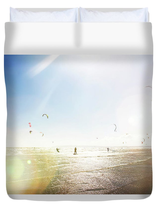 Water's Edge Duvet Cover featuring the photograph Kite Surfers by Nick David
