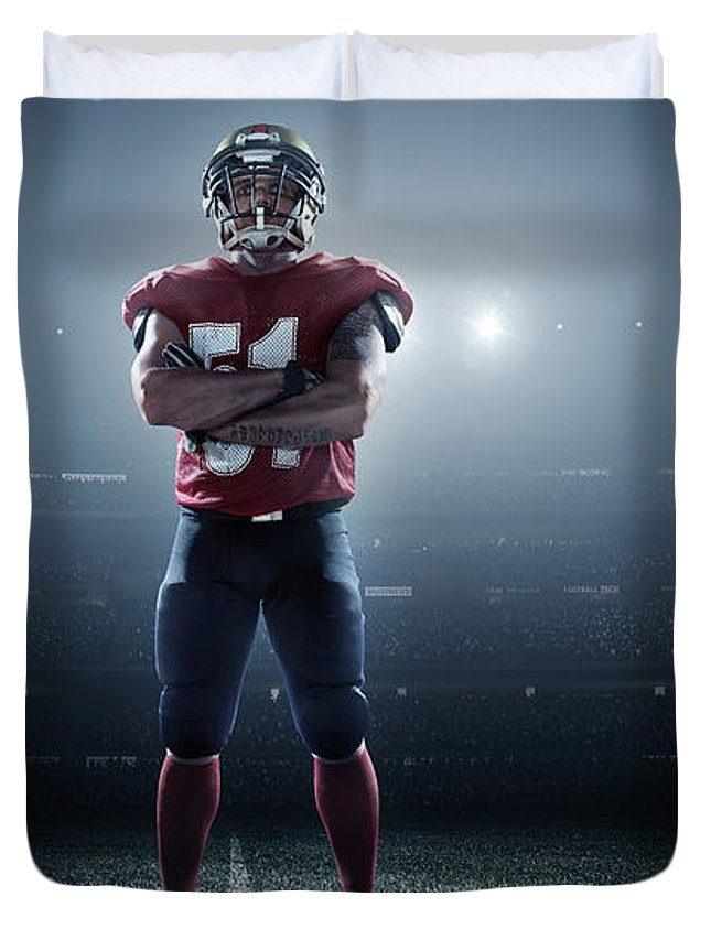 Soccer Uniform Duvet Cover featuring the photograph American Football In Action by Dmytro Aksonov