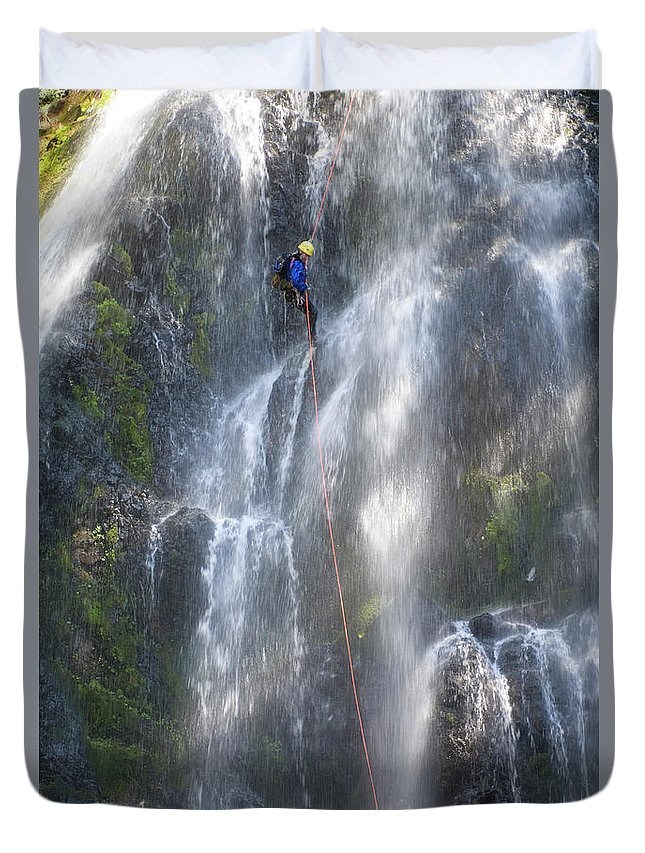 Abseil Duvet Cover featuring the photograph Man Canyoning Down A Waterfall by Frank Huster