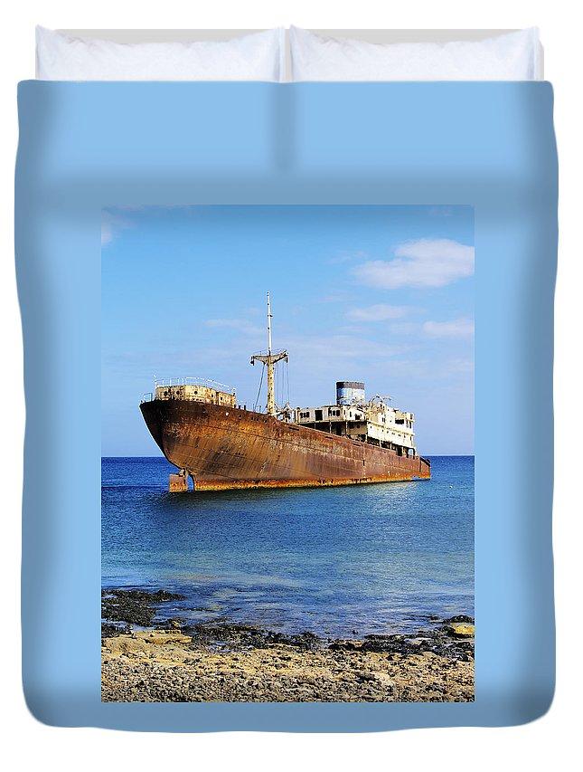 Wreck Duvet Cover featuring the photograph Shipwreck On Lanzarote by Karol Kozlowski