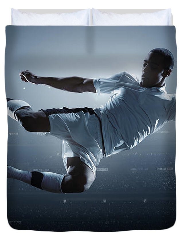 Goal Duvet Cover featuring the photograph Soccer Player Kicking Ball In Stadium by Dmytro Aksonov