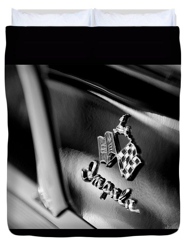 1958 Chevrolet Impala Emblem Duvet Cover featuring the photograph 1958 Chevrolet Impala Emblem by Jill Reger