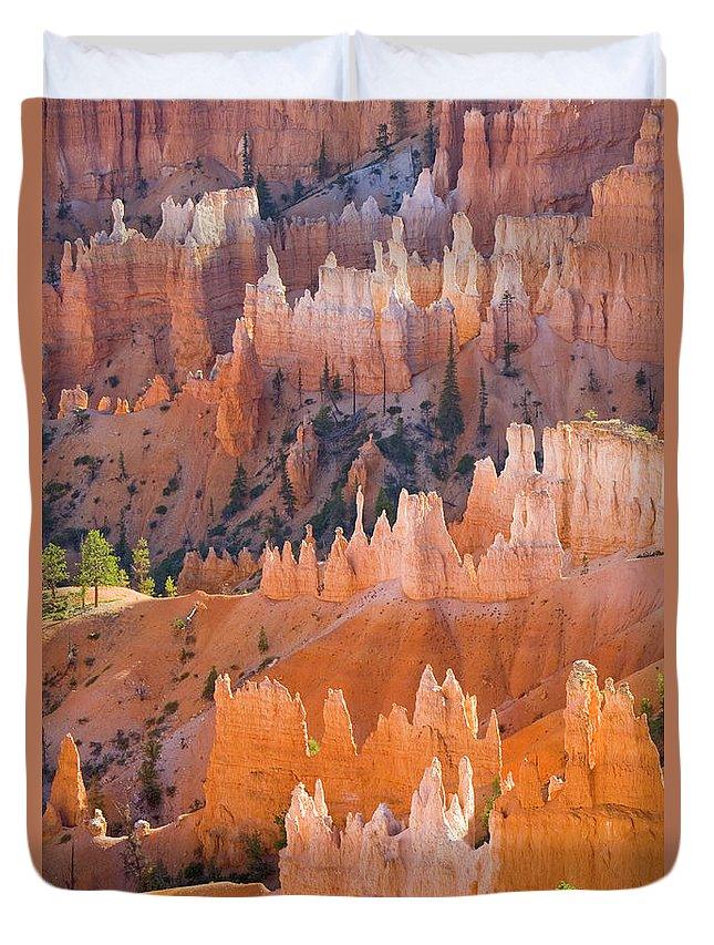00431147 Duvet Cover featuring the photograph Sandstone Hoodoos In Bryce Canyon by Yva Momatiuk John Eastcott