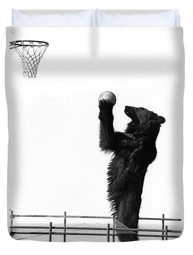 1960s Duvet Cover featuring the photograph A Basketball Bear by Underwood Archives
