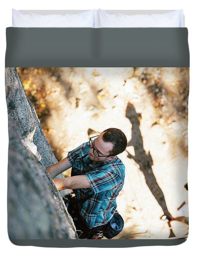 One Young Man Only Duvet Cover featuring the photograph A Climber Leading Hanging Flake 5.6 by Ryan Tuttle