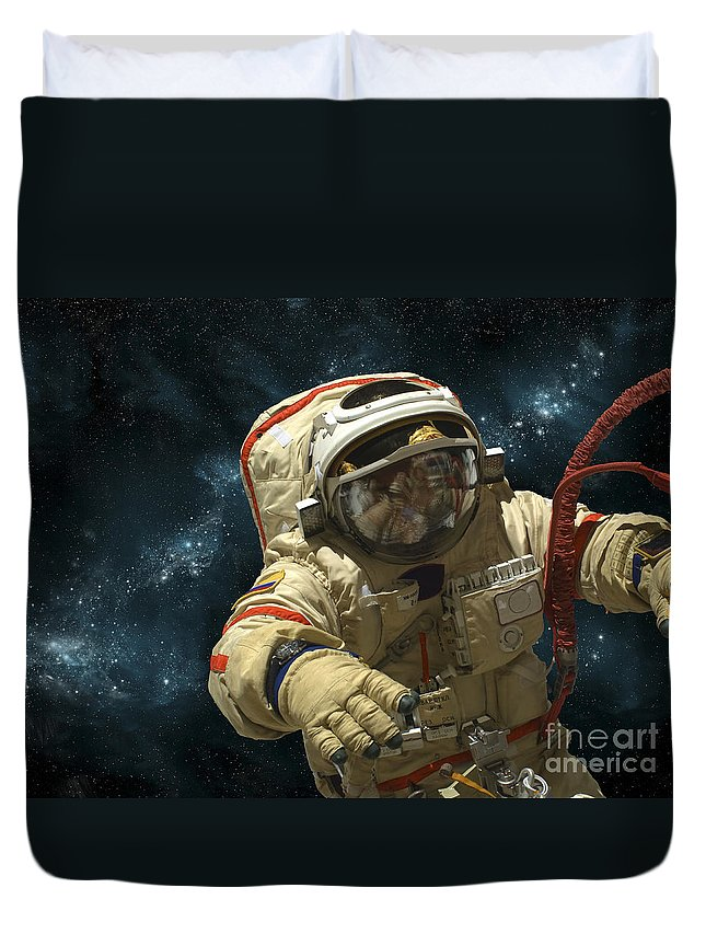 Astronaut Duvet Cover featuring the photograph A Cosmonaut Against A Background by Marc Ward