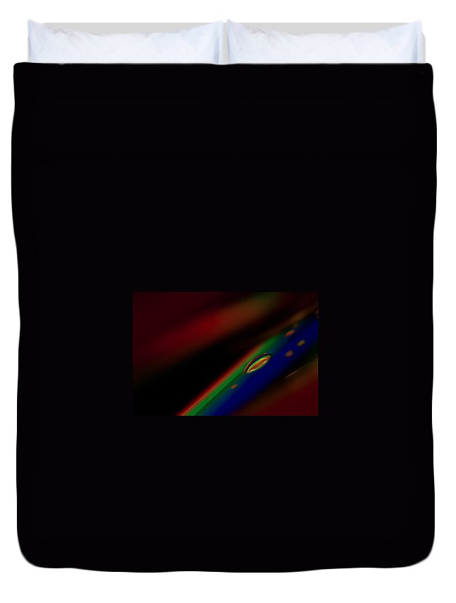Rainbow Color Red Orange Yellow Green Blue Indigo Violet Water Drop Refract Refraction Colorful Abstract Droplet Macro Cd Compact Disc Disk Black Stage Staging Sell Sale Real Estate Decoration Decorate Duvet Cover featuring the photograph A Drop Of Rainbow by Tom Gort
