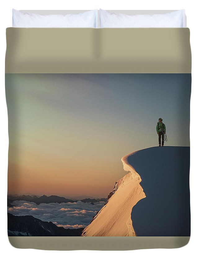 People Duvet Cover featuring the photograph A Female Climber On A Snowy Mountaintop by Buena Vista Images