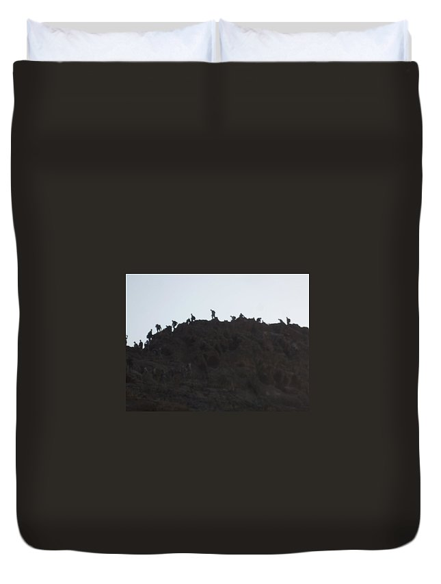 Mountain Duvet Cover featuring the photograph A Line Of People Walking On A Mountain by Shea Holliman