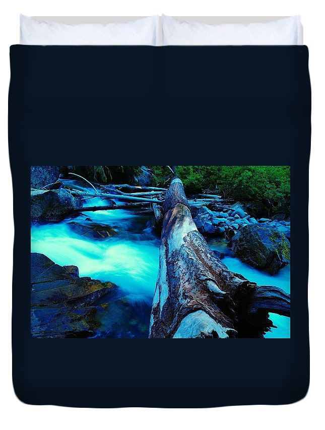 Log Duvet Cover featuring the photograph A Log Over Rapids by Jeff Swan