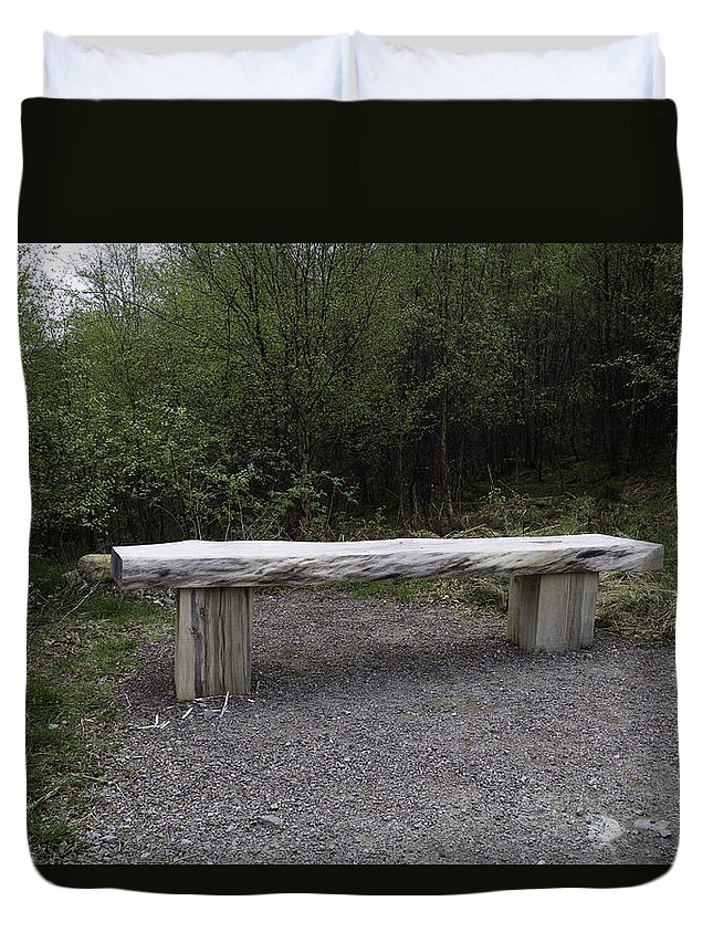 Bench Duvet Cover featuring the photograph A Long Stone Section Over Wooden Stumps Forming A Rough Sitting Area by Ashish Agarwal
