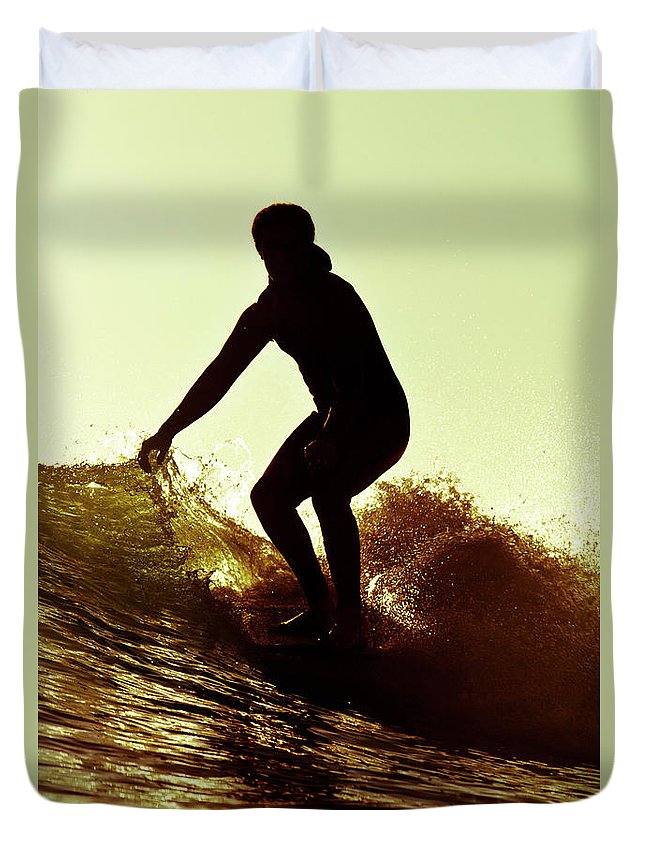 Designs Similar to A Male Surfer Rides A Longboard