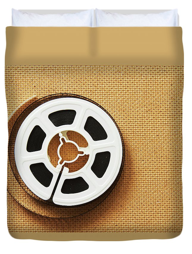 The Media Duvet Cover featuring the photograph A Reel, Or Spool, Of 8mm Movie Film by Jon Schulte