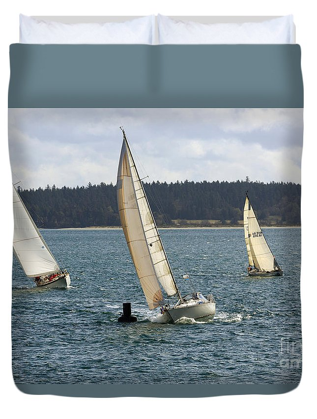 Sailing Duvet Cover featuring the photograph A Sailing Yacht Rounds A Buoy In A Close Sailing Race by Louise Heusinkveld