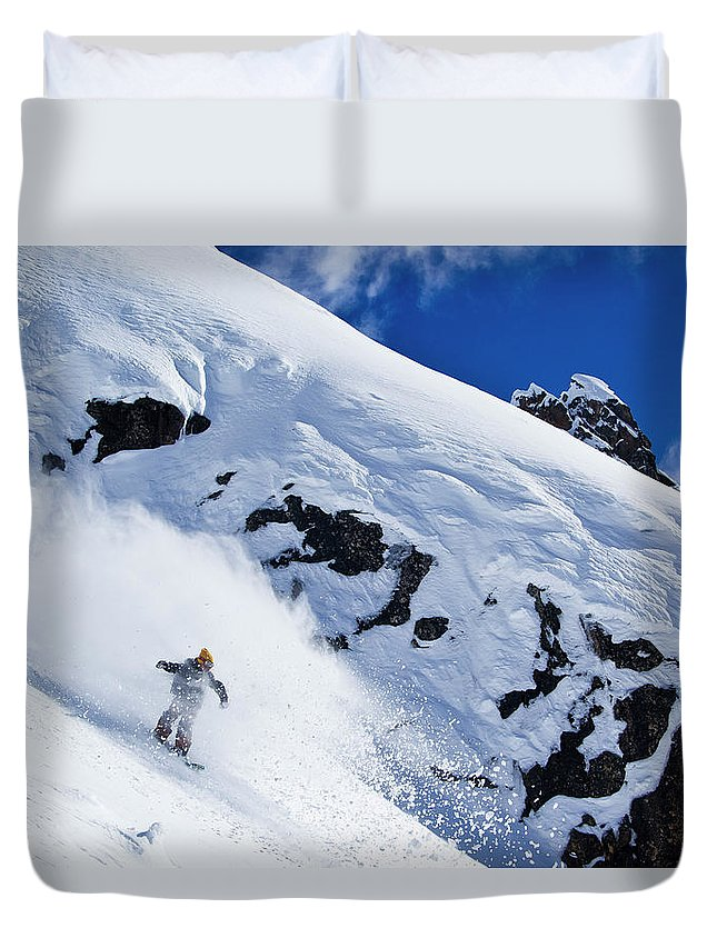 Outdoors Duvet Cover featuring the photograph A Snowboarder Slashes Powder Snow by Ben Girardi