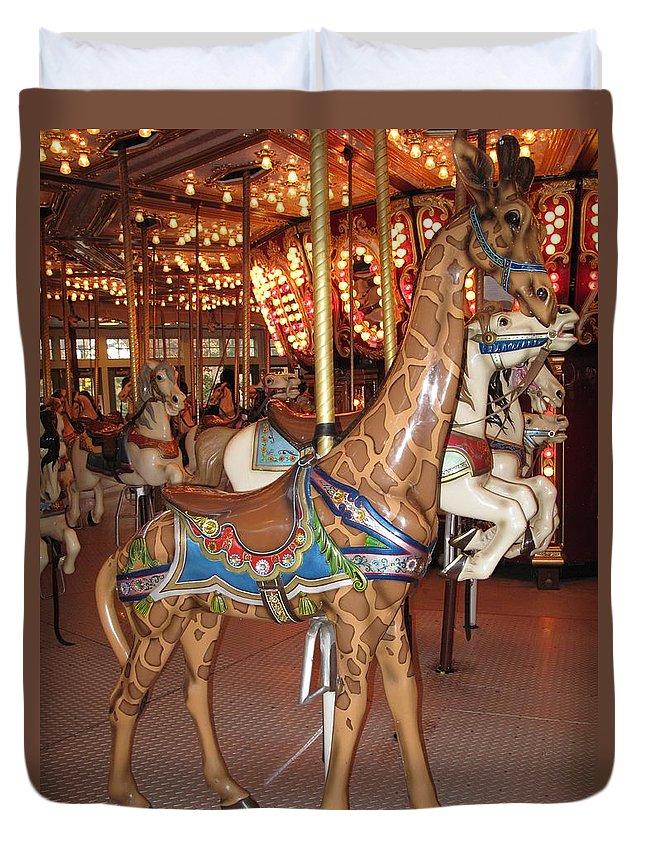 Carousel Duvet Cover featuring the photograph A Tall Ride by Barbara McDevitt