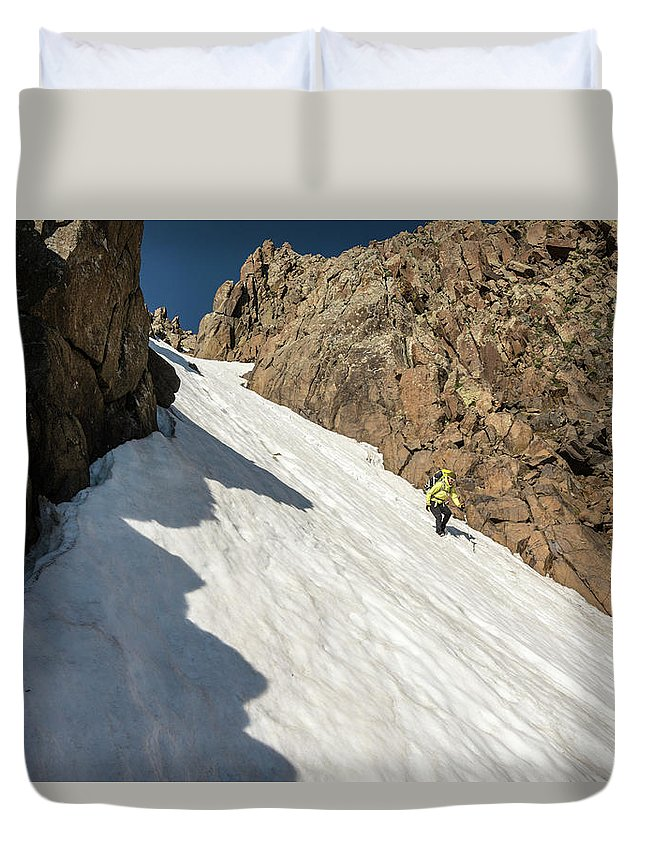 Low Angle View Duvet Cover featuring the photograph A Woman Descending A Snow Slope While by Kennan Harvey