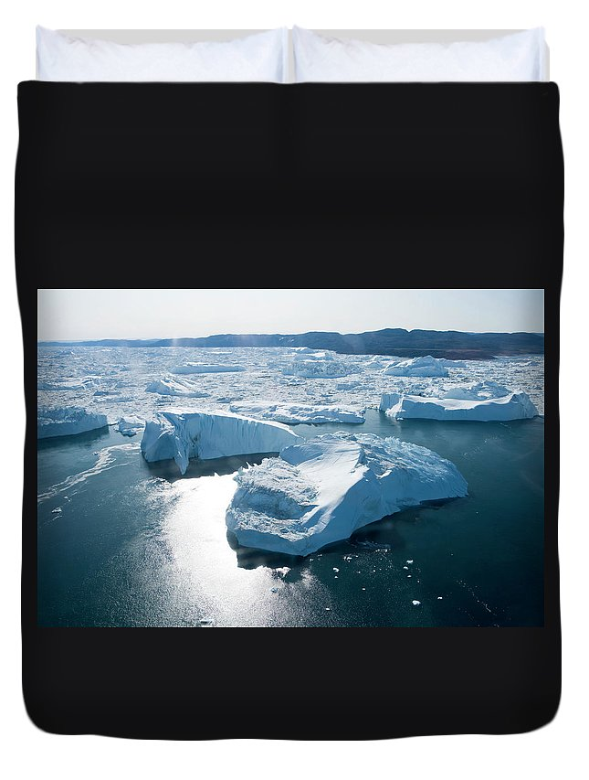 Melting Duvet Cover featuring the photograph Aerial Of Icebergs Of Ilulissat by Holger Leue