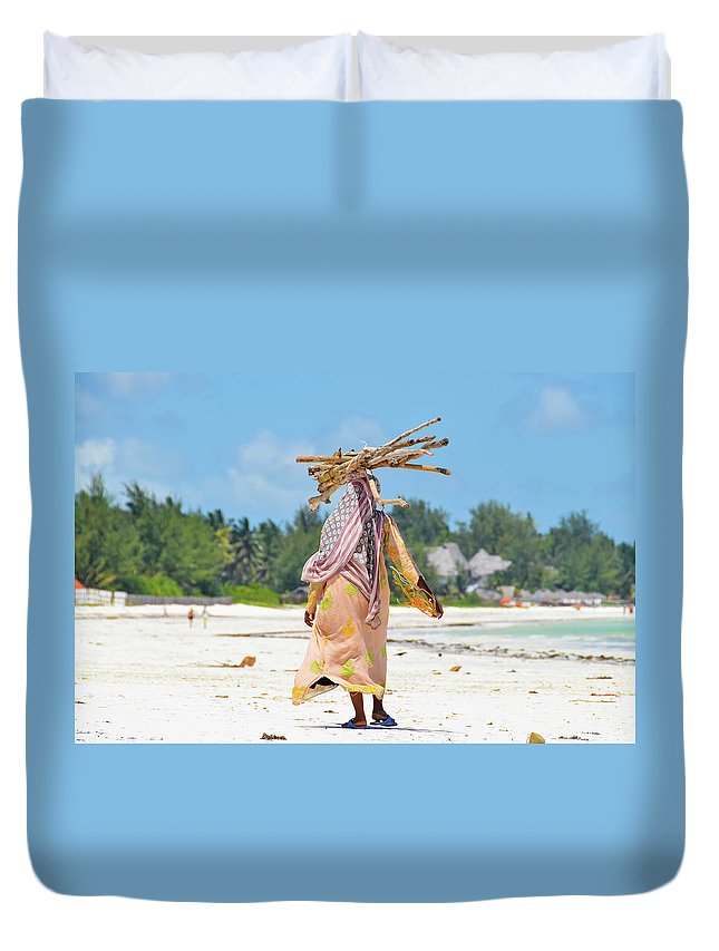 People Duvet Cover featuring the photograph African Girl With A Bundle Of Reeds On by Volanthevist