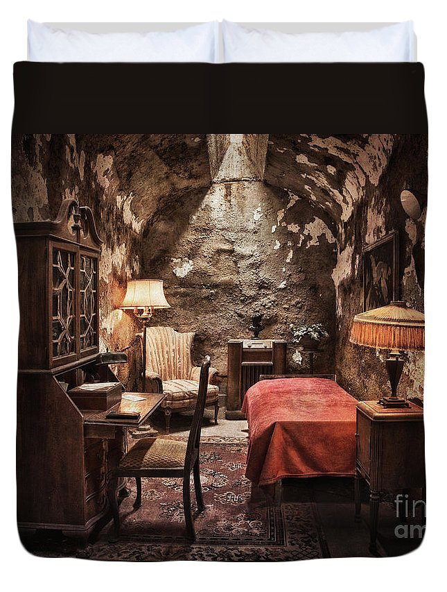 Penitentiary Duvet Cover featuring the photograph Al Capone's Cell by Claudia Kuhn