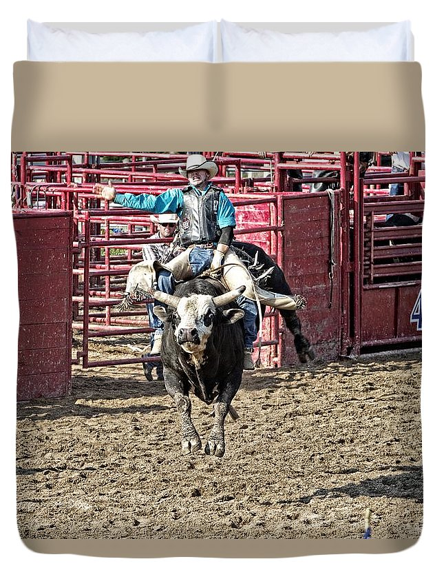 Bullriding Duvet Cover featuring the photograph All Four Feet Up by Alice Gipson