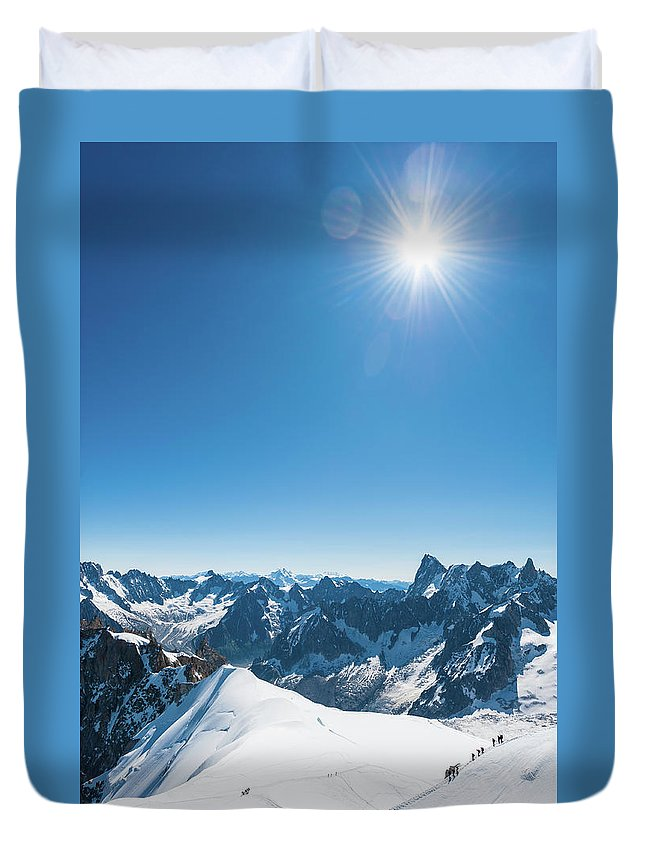 Scenics Duvet Cover featuring the photograph Alps Snow Summit Sunburst Mountaineers by Fotovoyager