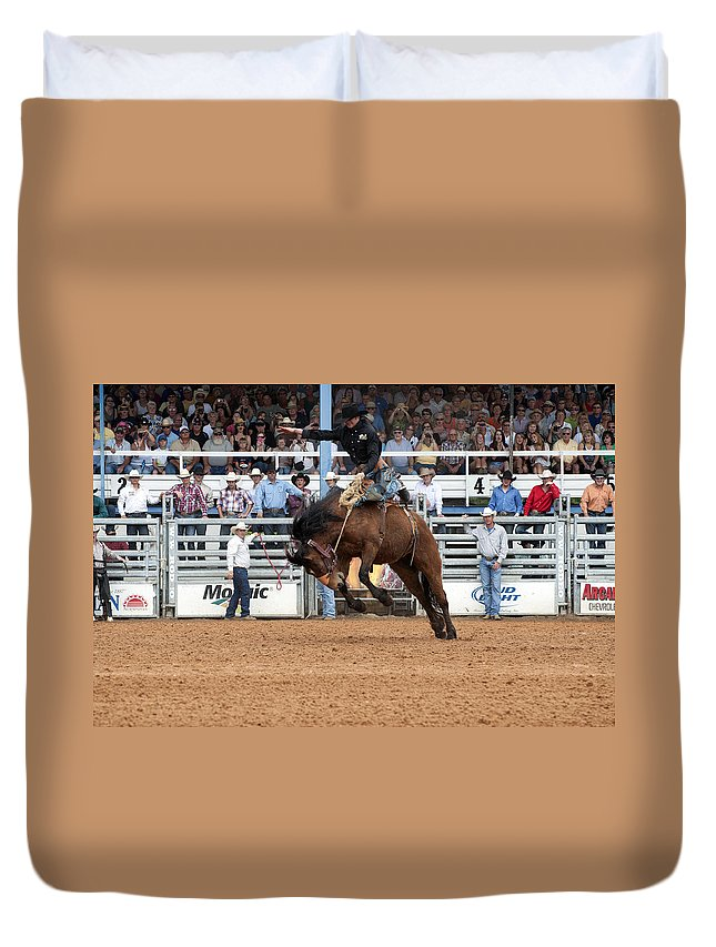 Rodeo Duvet Cover featuring the photograph American Cowboy Riding Bucking Rodeo Bronc I by Sally Rockefeller