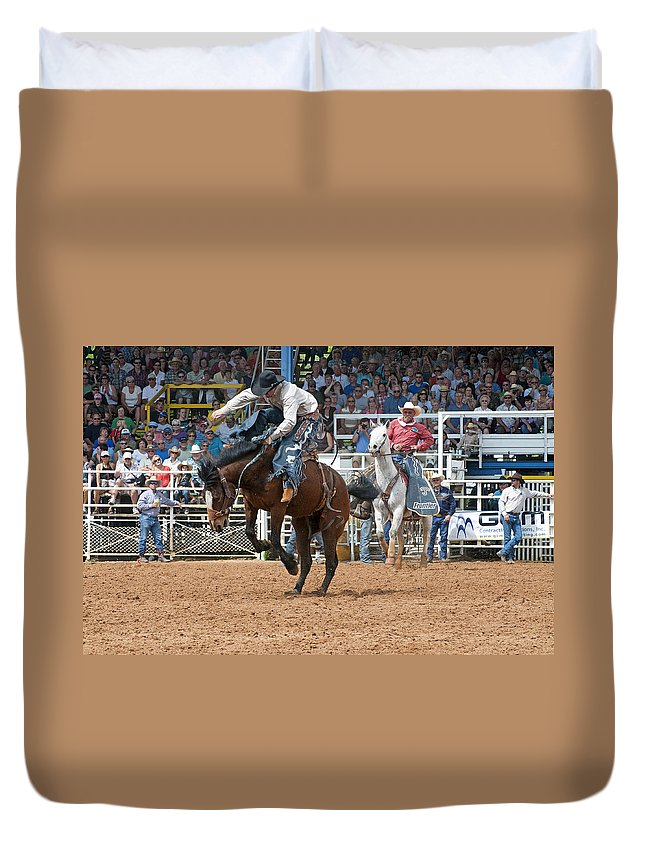 Rodeo Duvet Cover featuring the photograph American Cowboy Riding Bucking Rodeo Bronc II by Sally Rockefeller
