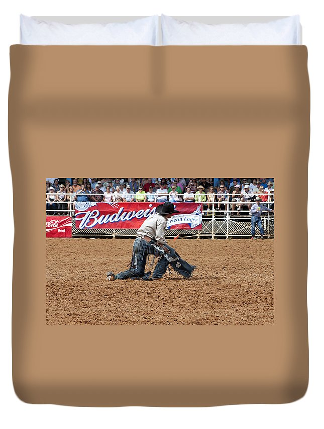 Rodeo Duvet Cover featuring the photograph American Cowboy Thrown From A Bucking Rodeo Bronc by Sally Rockefeller