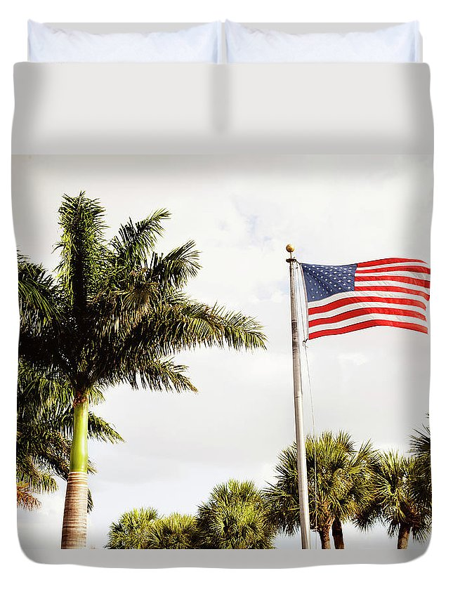 Tranquility Duvet Cover featuring the photograph American Flag Flying Amongst Palm Trees by Ron Levine