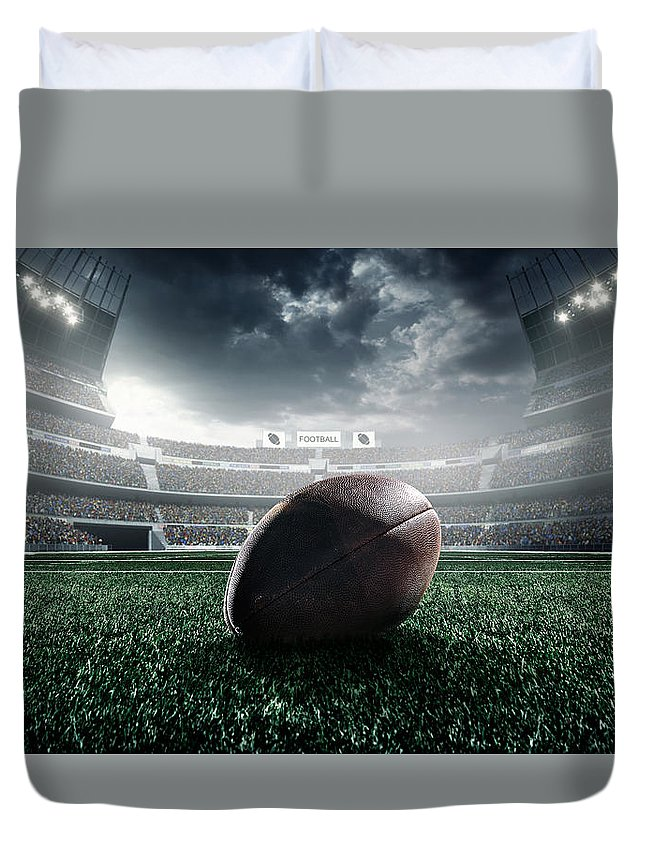 Event Duvet Cover featuring the photograph American Football Ball by Dmytro Aksonov