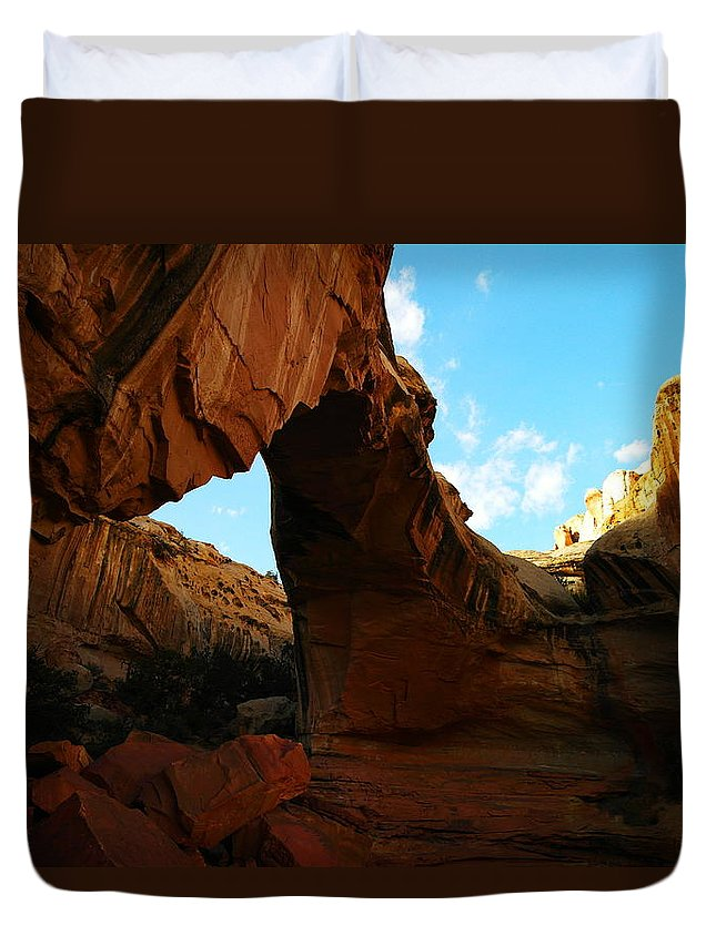 Arch Duvet Cover featuring the photograph An Arch At Capital Reef by Jeff Swan